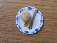 Scone serving on small plate - F105