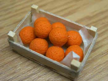 Oranges in a wood box