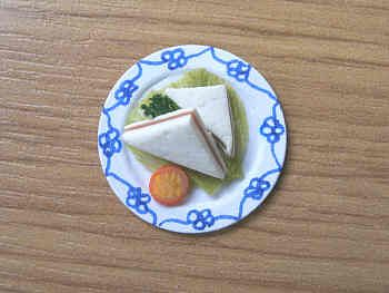 Sandwich serving on small plate