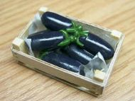 Aubergines in wood box - F135