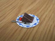 Chocolate Fudge Cake slice on plate - F256
