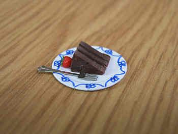 Chocolate Fudge Cake slice on plate