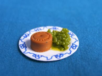 Pie and peas on plate