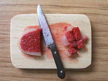 Raw Meat on chopping board - F44