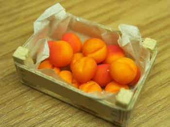 Peaches in a wood box