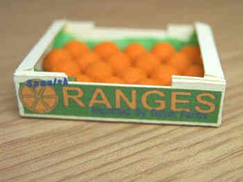 Oranges in printed carton