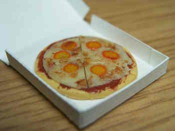 Pizza in takeaway carton